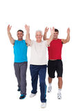 Fit men stretching their arms Stock Images
