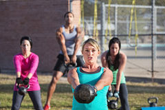 Fit Men and Women Exercising Outdoors Stock Photo