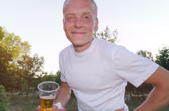 Fit middle-aged man enjoying a glass of beer royalty free stock photography
