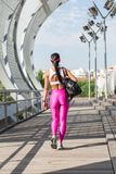 Fit middle-aged woman walking after training in park. Female athletic runner in park in the summer, walking after a jog, fitness and healthy lifestyle concept Stock Images