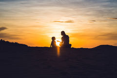 Fit mother with son running at the desert in Gran Canaria, Maspa Royalty Free Stock Images