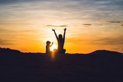 Fit mother with son running at the desert in Gran Canaria, Maspa Royalty Free Stock Photos
