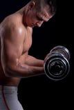 Fit muscular man exercising Stock Photo
