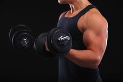 Fit muscular man exercising with dumbbell Royalty Free Stock Photography
