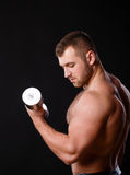 Fit muscular man exercising with dumbbell Royalty Free Stock Image