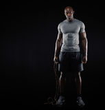 Fit and muscular man with jumping rope Stock Image