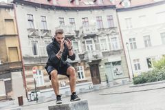 Healthy routine with city surroundings. Stock Photo
