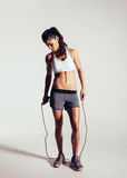 Fit and muscular woman with jumping rope Royalty Free Stock Photos