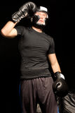 Fit muscular young boxer Stock Photos