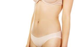 Fit och slank ung kvinnabuk royaltyfri foto