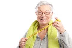 Fit old lady with tape measure smiling Stock Image