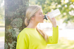 Fit peaceful blonde drinking from water bottle Stock Photography