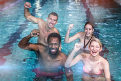 Fit people cycling in pool Royalty Free Stock Image
