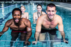 Fit people cycling in the pool Royalty Free Stock Photo