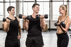 Fit people do some weightlifting together Stock Photography