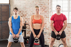 Fit people do some weightlifting together Royalty Free Stock Photo