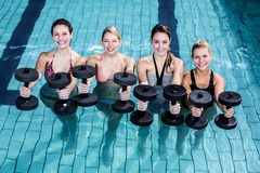 Fit people doing an aqua aerobics class Stock Photo