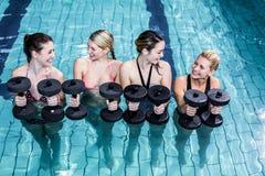 Fit people doing an aqua aerobics class Royalty Free Stock Photography