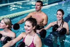 Fit people doing an aqua aerobics class Royalty Free Stock Image