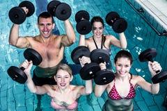 Fit people doing an aqua aerobics class Stock Image