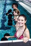 Fit people doing an aqua aerobics class. In swimming pool Stock Image