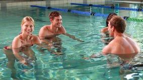 Fit people doing an aqua aerobics class in swimming pool Stock Image