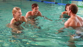 Fit people doing an aqua aerobics class in swimming pool Royalty Free Stock Photos