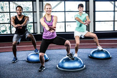 Fit people doing exercise with bosu ball Stock Photos