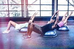 Fit people doing exercise with bosu ball Stock Images