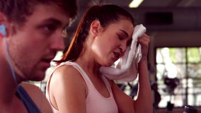 Fit people doing exercise with elliptical machine. In crossfit stock video