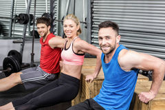 Fit people doing exercises with box Royalty Free Stock Photos