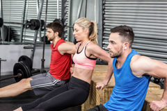 Fit people doing exercises with box Stock Photography