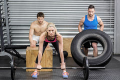 Fit people doing exercises Stock Photo