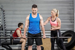 Fit people doing exercises. At crossfit gym Stock Images