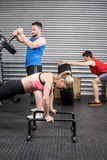 Fit people doing exercises Royalty Free Stock Photo
