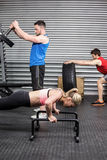 Fit people doing exercises Stock Images