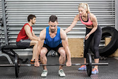 Fit people doing exercises. At crossfit gym Royalty Free Stock Photo