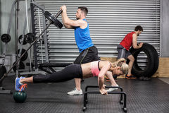 Fit people doing exercises Stock Photography