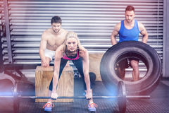 Fit people doing exercises Stock Image