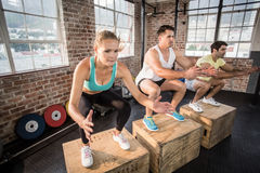Fit people doing jump box Royalty Free Stock Images