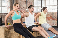 Fit people doing some exercises with box Royalty Free Stock Photos