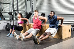Fit people exercising together Stock Photos