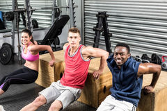 Fit people exercising together Royalty Free Stock Images