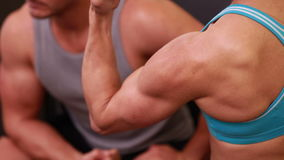 Fit people flexing their muscles. At the gym stock footage