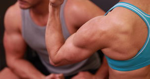 Fit people flexing their muscles. At the gym stock video footage