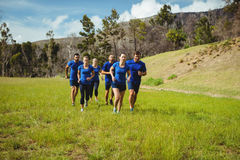 Fit people jogging in boot camp Royalty Free Stock Photo