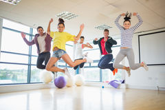 Fit people jumping in bright exercise room Stock Images