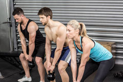 Fit people lifting dumbbells Royalty Free Stock Photography