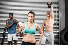Fit people lifting dumbbells Royalty Free Stock Photo
