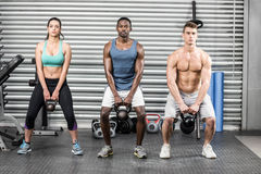Fit people lifting dumbbells royalty free stock images